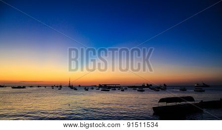 Boats At Sunset Lying In The Harbour Of Stonetown Zanzibar
