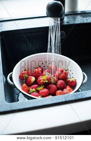 organic strawberries in colander