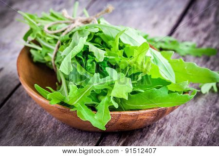 Organic Arugula Bundle In A Wooden Bowl