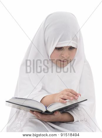 Little Muslim Girl Reading Quran