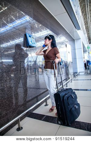 Woman calling on the phone at the airport