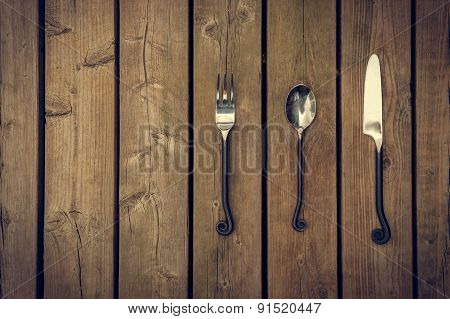 Cutlery - Fork, Spoon And Knife On Wooden Background
