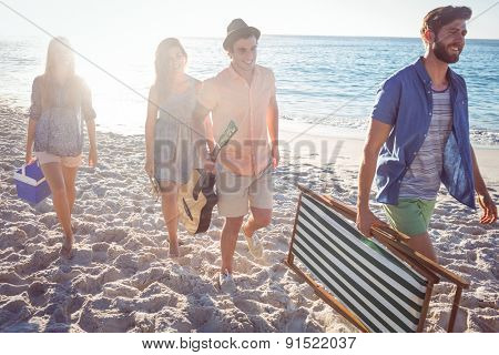 Happy friends having fun together at the beach