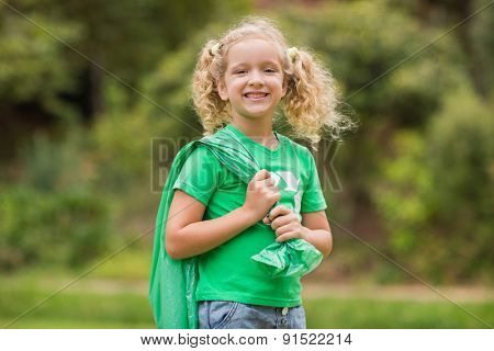 Eco friendly little girl smiling to camera on a sunny day