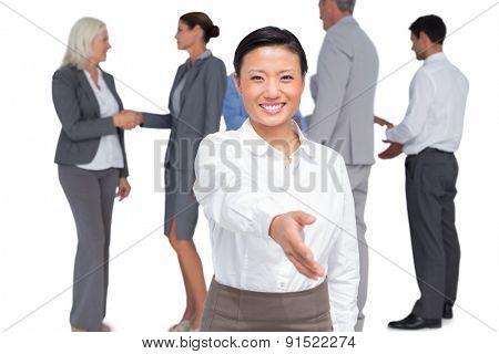 businesswoman offering handshake on white background