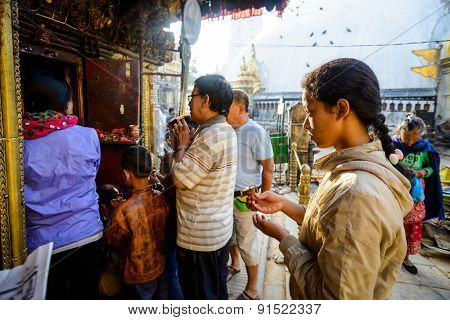 KATHMANDU, NEPAL - MAY 22, 2015: People praying at Swayambhunath which was severely damaged after two major earthquakes hit Nepal on April 25 and May 12, 2015.