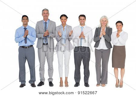 Smiling business people applauding on white background