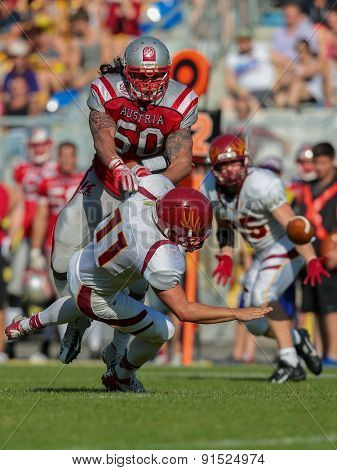VIENNA, AUSTRIA - MAY 26, 2014: LB Ramon Azim (#50 Austria) makes a tackle in match against Denmark during the EFAF European Championships 2014 in Austria.