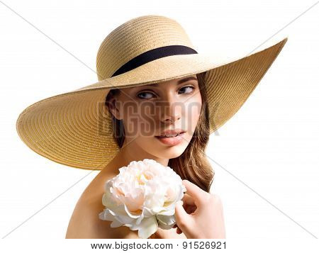 Young woman with flower in straw hat