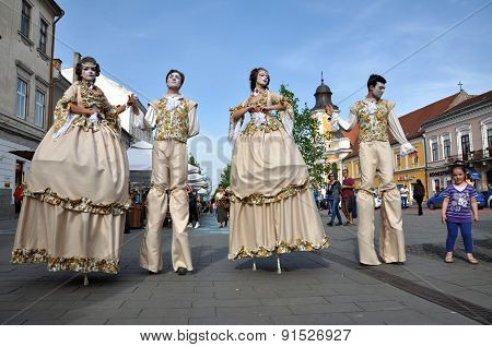 Artists On Stilts Performing In Medieval Costumes