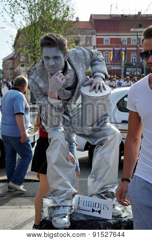 Street Performer, Living Statue In Silver Costume