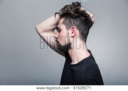 Professional studio portrait of young handsome man