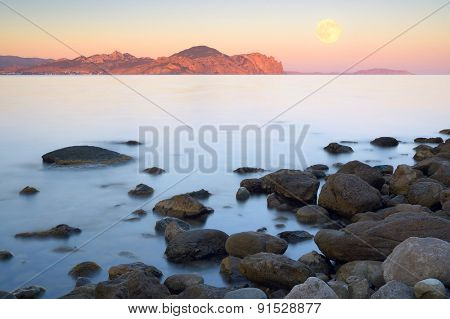 Morning landscape on the sea. Beach with stones
