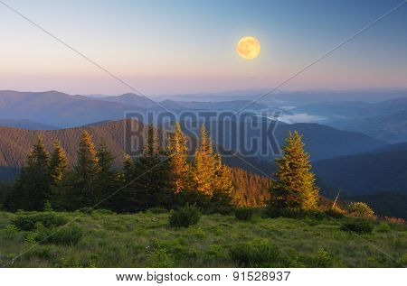 Mountain landscape. Morning light. The full moon. Beauty in nature