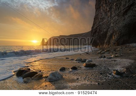 Sunset with beautiful sky. Seascape with rocks. Beauty in nature