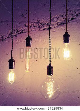 Illuminated Light Bulbs On Purple Background
