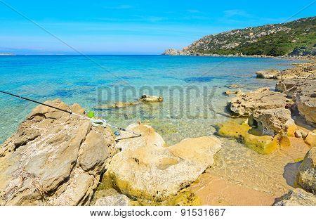 Fishing Rod On The Rocks In Capo Testa