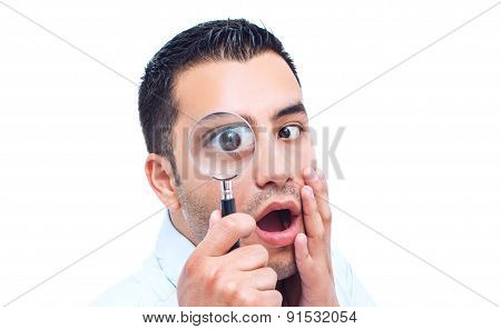 Young Amazed Man Looking With Magnifier, Isolated On White Background