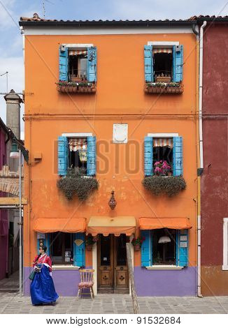 Burano, Italy - 21 May 2015: Brightly Painted Building. One Of The Many Different Coloured Painted B