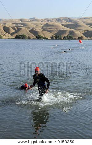 Triathletes Finish Swimming Leg