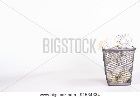 isolated wastebasket full of white waste paper