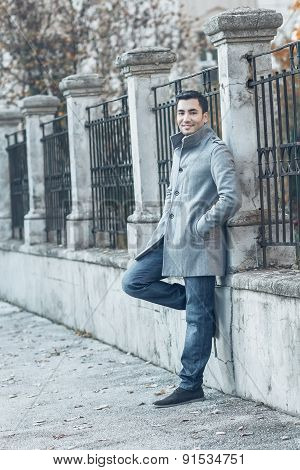 Gorgeous Man Standing Wearing Over Coat In A Coldly Morning. Outdoors - Outside. Fashion Photo