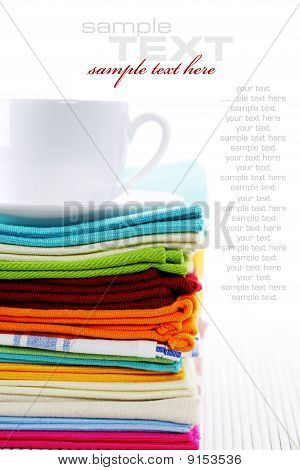 Pile Of Linen Kitchen Towels And Cup Of Tea Or Coffee