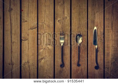 Vintage Cutlery - Fork, Spoon And Knife On Wood Background