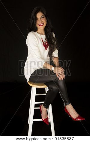 Beautiful Woman Posing On A Bar Stool Smiling