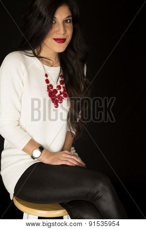 Pretty Woman Sitting On A Barstool Red Necklace And Bright Red Lipstick