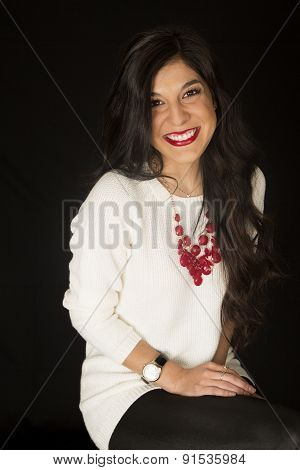 Pretty Dark Woman Sitting Smiling White Sweater Red Necklace