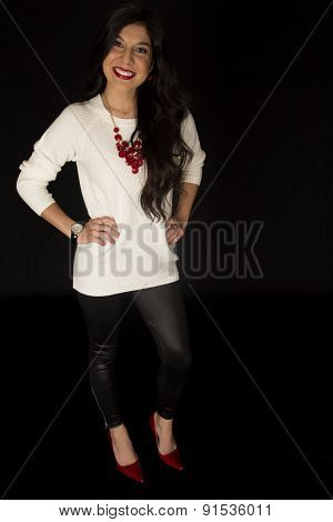 Pretty Woman Smiling Standing Wearing White Sweater And Black Pants