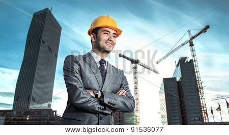 Successful Engineer Or Architect, Crane And Building Construction At Backgrpound. Joyous Businessman