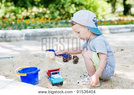 Toddler Boy Playing In The Sand