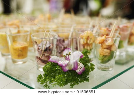 Seafood Served In Glass Cups On Table
