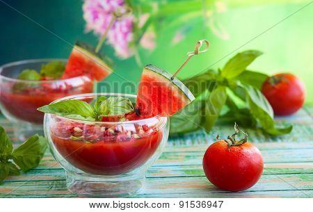 Watermelon tomato gazpacho in  glass bowls
