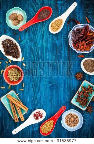 Various asian spices  on a blue wooden background. Top view