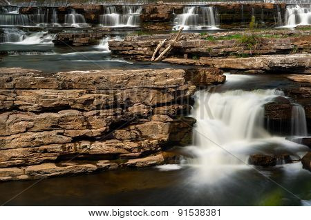 Many Waterfalls Cascading Over Rocks