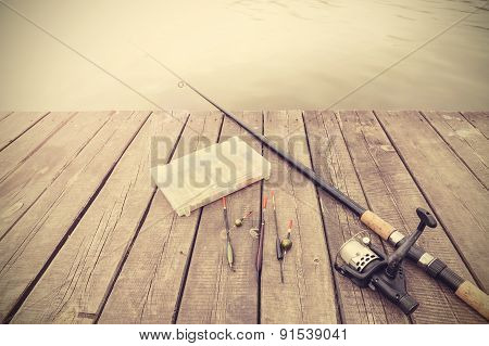 Retro Toned Picture Of Fishing Equipment.