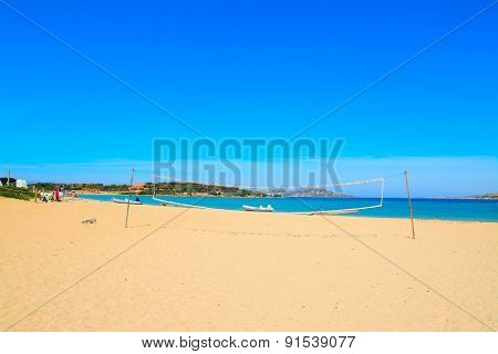 Beach Volley Net And Rubber Boats In Porto Pollo