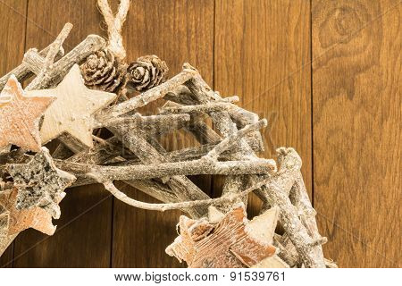 Closeup Of Christmas Decoration With Twigs, Brown Pine Cone And Wooden Stars On Wooden Background