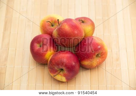 Red apples on support colour of a tree