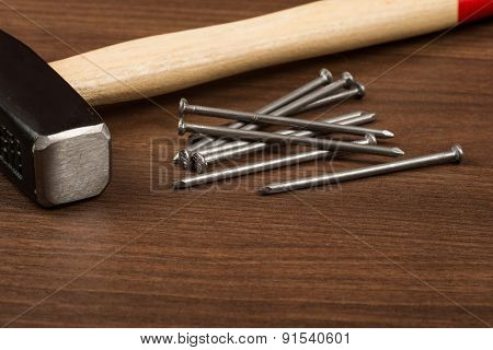 Hammer and nails on table