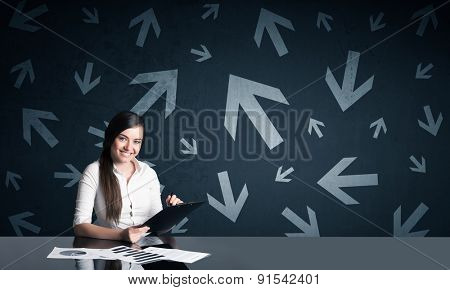 Successful businesswoman with arrows in background