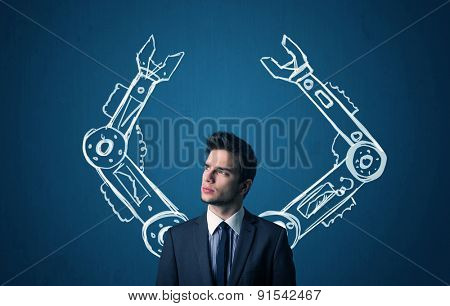 Businessman with robotic arms concept