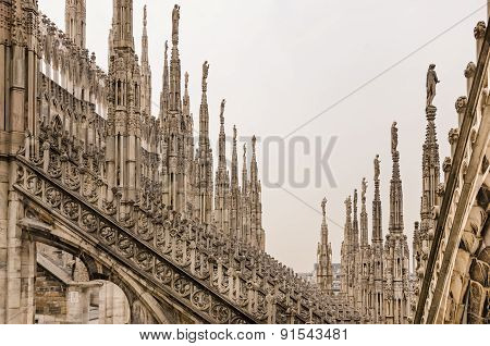 Detail View Of Stone Sculptures On Roofs Of Duomo Milano