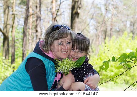 Girl In The Woods With A Bouquet
