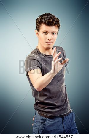 Portrait of a handsome young man explaining something and gesturing with his hands. Businessman. Men's beauty, fashion.