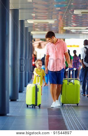 Happy Father And Son Are Going For Boarding On Airplane, Summer Vacation