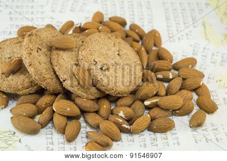 Decoupage Table Covered With Raw Almonds And Cookies